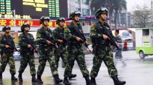 Chinese security forces patrol Guangzhou Railway Station after March 6 attack (Photo: CNN)